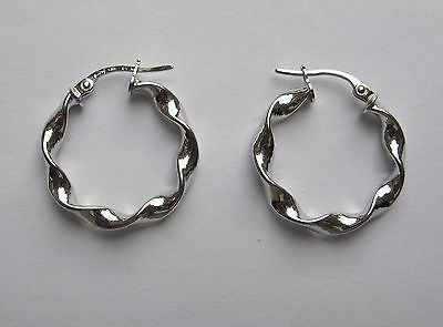 fa17fb629 2cm wide 9Ct White Gold lightweight high polished twist Hoop Earrings 1g  variant attributes variant attributes variant attributes. Condition: New