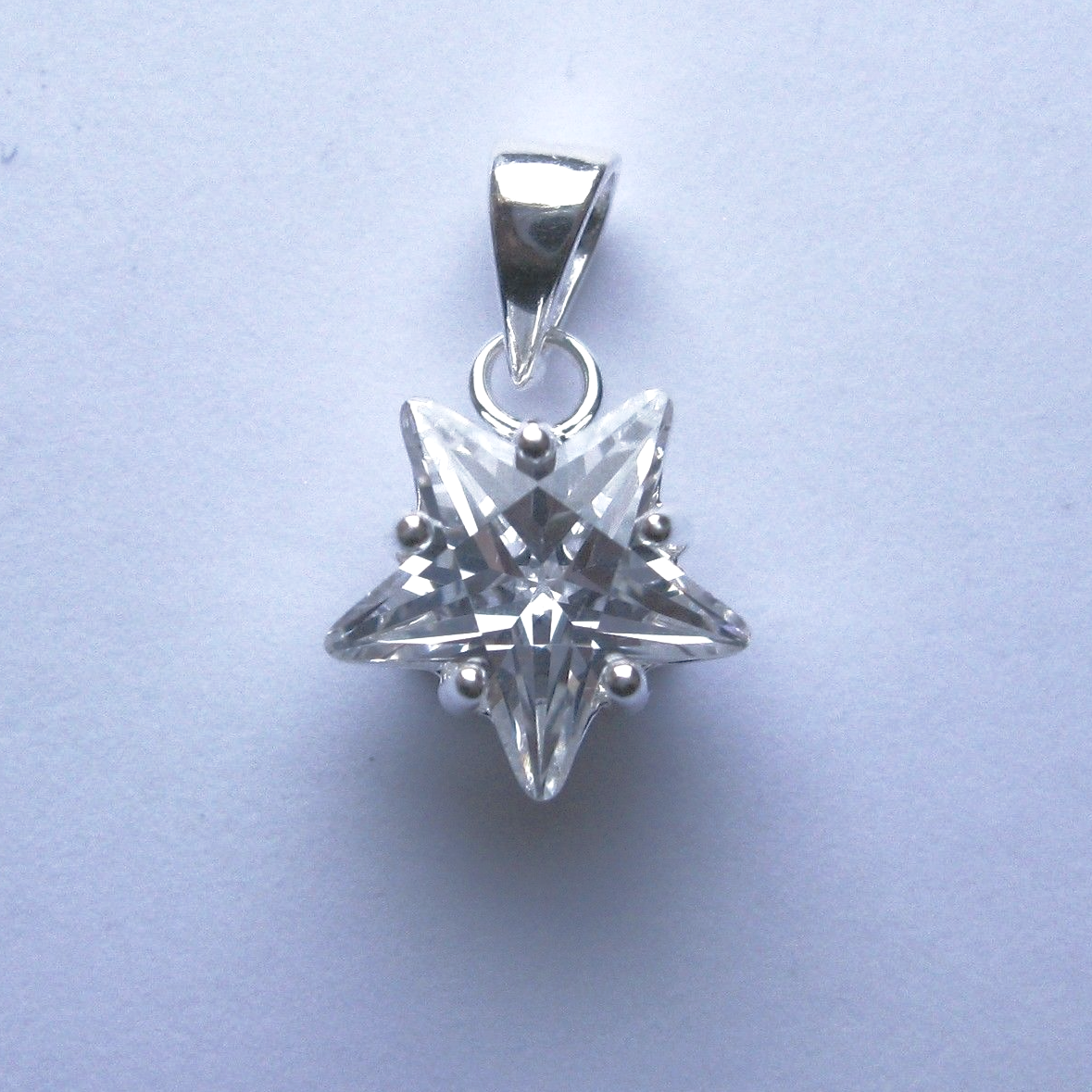 Sterling silver star shaped cubic zirconia pendant aloadofball Image collections